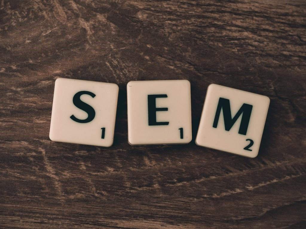 Scrabble tiles spelling S.E.M.
